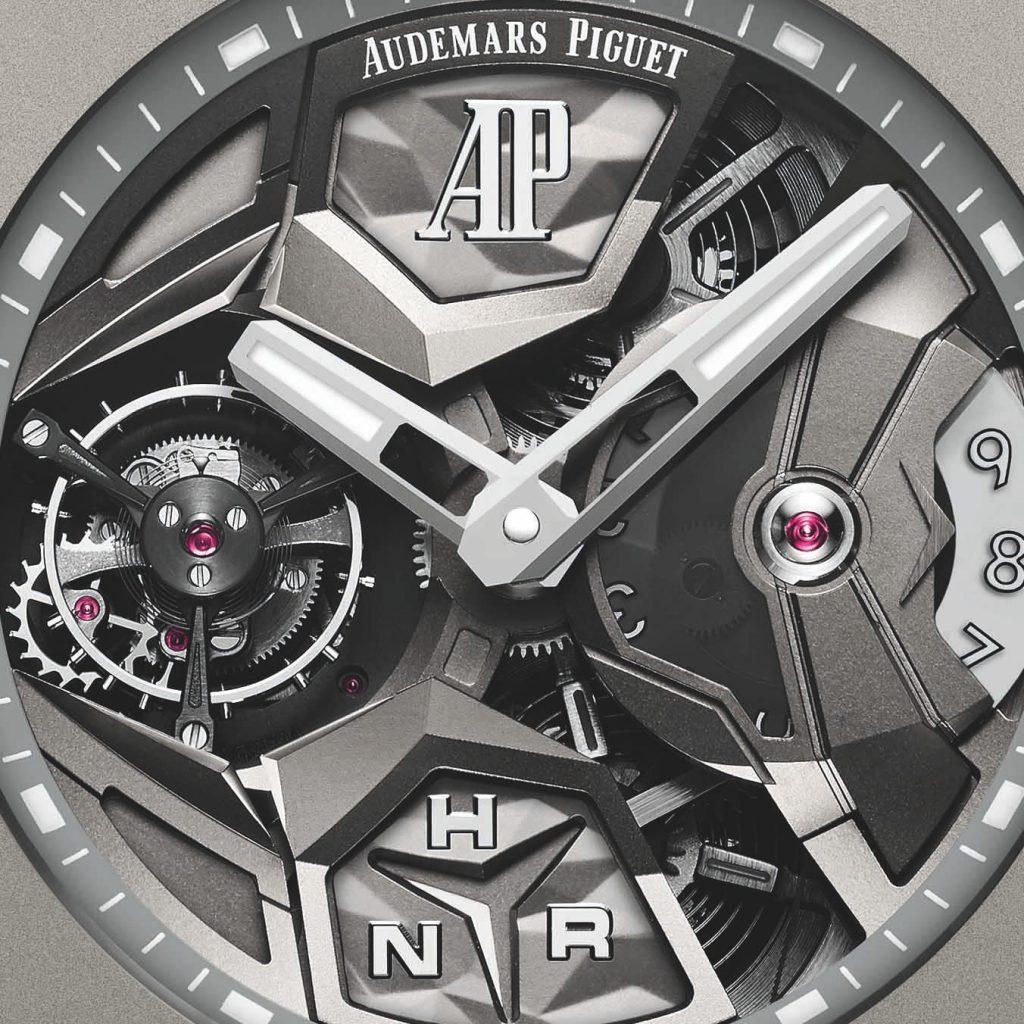 לוח השעון עם מנגנון הטורבילון בשעה 9 וקומפליקציית ה-GMT בשעה 3. מקור - Hodinkee.