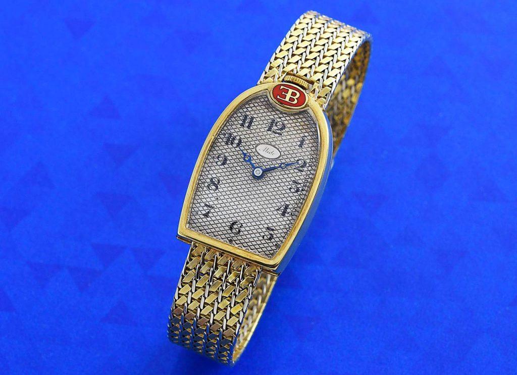לוגו החברה והלוח המעניין. מקור - Vintage Watch Story.